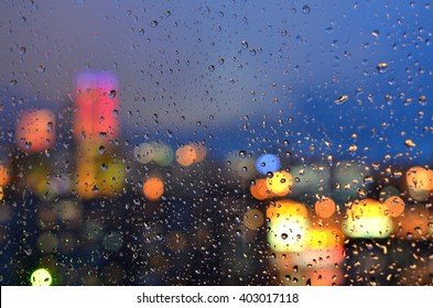 Blurred background with drops on a window glass