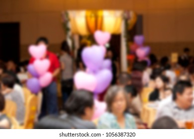 Blurred background of a empty table inside a ballroom.