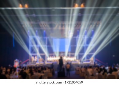blurred background of event concert lighting at conference hall.