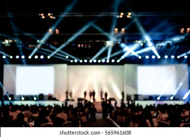 blurred background of event concert lighting at conference hall, spotlight with laser rays