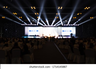 blurred background of event financial charity, blur of light on stage