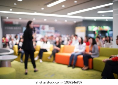 blurred background of female business people presenting in the hall
