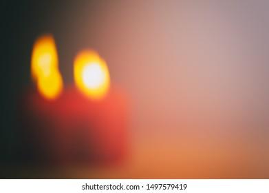 Blurred background, festive burning candles. Christmas background. Web banner.
