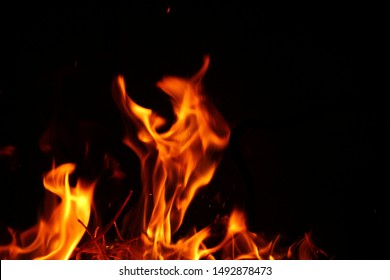 Blurred background. Fire flames pattern on black.