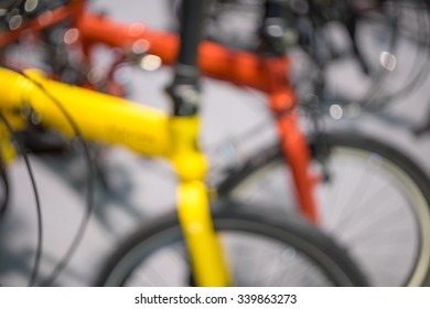 Blurred background of folding bicycle.