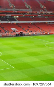 Blurred background of football stadium and soccer goal in match day on beautiful green field with sport light at the stadium.Sports,Athlete,People Concept.Emirates Stadium,Arsenal.