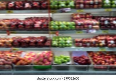 blurred background of fruit shelf at the supermarket