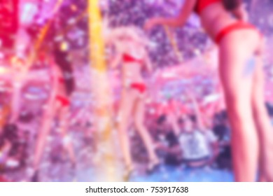 Blurred for background. Go go dancer. Dance show at night club. Performance show during night party.