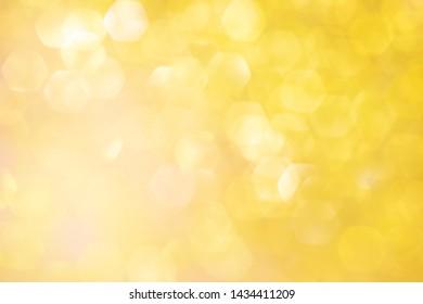 Blurred background - golden sparkles. Abstract image. Bright color. Abstract beautiful fasion bokeh.