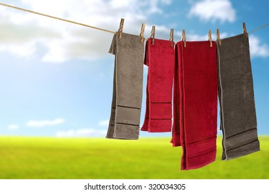 blurred background of grass and sky with towels of summer time