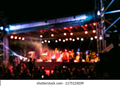 Blurred background of Great band playing outstanding concert, live concert in Jazz Festival night performance main stage nearby seaside. Band performs on stage, rock music concert in a nightclub.