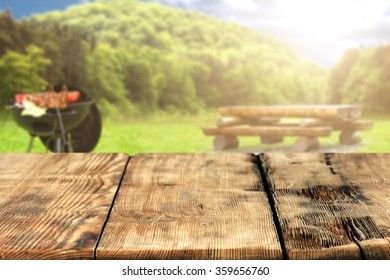 blurred background of grill worn wooden space and wooden deck