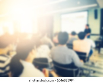 Blurred background of happy and fun professional successful business conference. Use in workshop, training lecture, seminar event