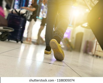 Blurred background of happy old aging Asian woman tourist vacation trip hold luggage, passport and flight, travel during festival long holidays in crowed international airport passenger terminal gate