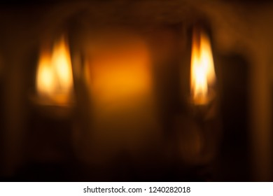Blurred background with holiday candle lights