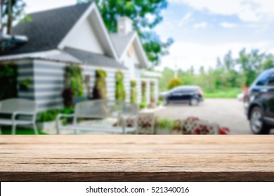 Blurred background of home garden picnic and wooden table free space for product display.