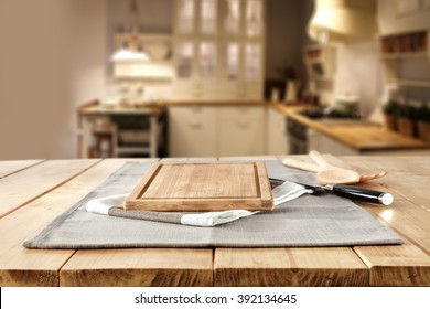 blurred background of home kitchen place and desk napkin and knife