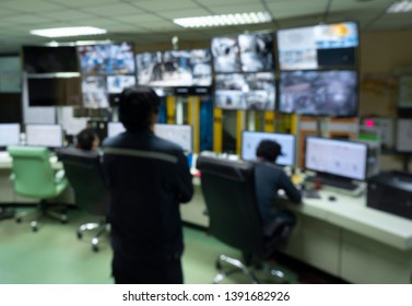 Blurred background image Of engineers and workers in the production control room in industrial plants in Asia