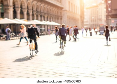 Blurred background image with people walking in the morning on Duomo square in Milan