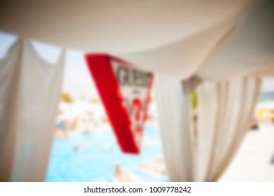 Blurred for background Interrior of Elite comfortable beach resort with palm trees and pools. restaurant beach club highest level at resort for a holiday in beach season.
