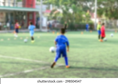 blurred background kid soccer player in academy