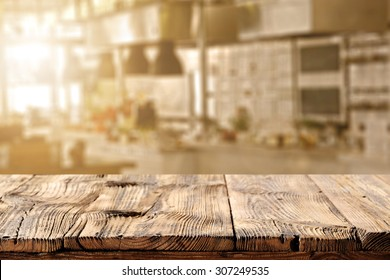 blurred background of kitchen of sun light and dirty table