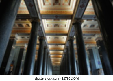 Blurred background. Large magnificent hall with columns.