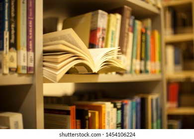 Blurred background. Library, books. Close-up.