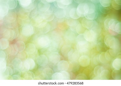 Blurred background in light green tones with bokeh lights
