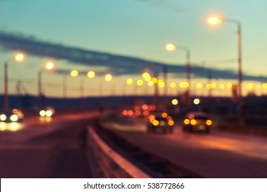 Blurred background with lights of the city at night. Big city bridge. Bokeh basic background for design