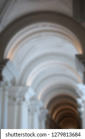 Blurred background. Long passageway with vaulted ceiling and columns
