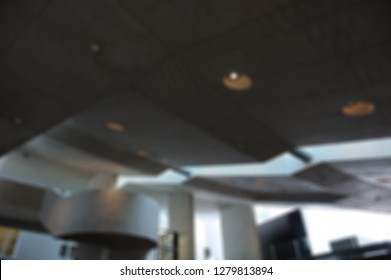 Blurred background. Low dark ceiling with lights