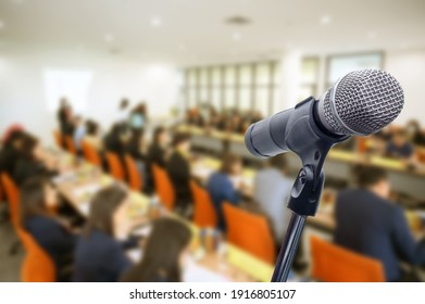 Blurred background Microphone in conference hall or seminar room with business people.