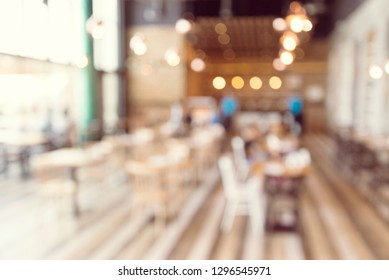 Blurred background of modern cafe restaurant table blur background with bokeh light.s, eisure lifestyle, urban daily cafe bar