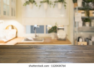 Blurred background. Modern defocused pastel kitchen with empty wooden tabletop and space for you design.