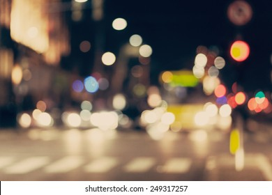 Blurred background. Night city lights blur. Retro toned photo, vintage.