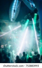 Blurred for background. Night club dj party people enjoy of music dancing sound with colorful light with Smoke Machine and lights show. Hands up in earth