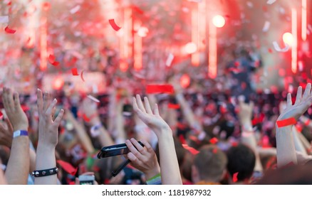 Blurred for background. night club party. Night club dj party people enjoy of music dancing sound with colorful light with Smoke Machine and lights show. Hands up in earth.