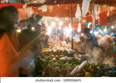 Blurred background of night market in Chiang Mai, Thailand.