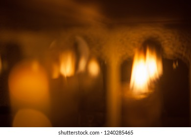 Blurred background with oil candles in a glass box with arabesque Middle Eastern pattern