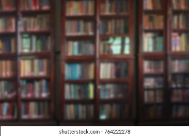 Blurred background with old bookcases.