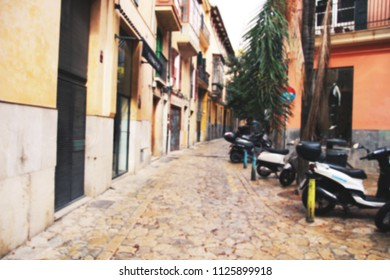 Blurred background of an old street with vintage motorcycles, Palma de Mallorca, Spain