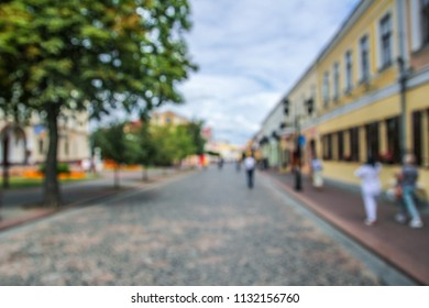 blurred background of an old tourist european street in a bright sunny day. concept travel to Europe.