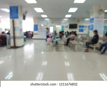 blurred background of Out Patient Department(OPD) of a hospital with patients.