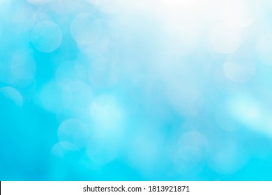 Blurred background in pale blue tones with a slight gradient. Bokeh. For design work.
