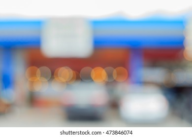 Blurred background parking lot of the Texaco service station and restaurant in a gas station.