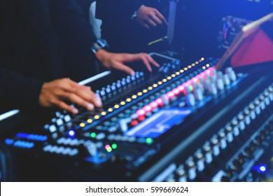 Blurred background of party DJ mix tracks on digital turntable and laptop with professional dj software for mixing.Disc jockey play music show on stage.Music festival blurry back ground