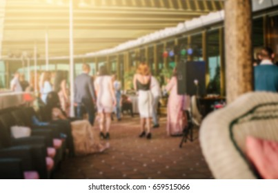 Blurred background of a party in a restaurant