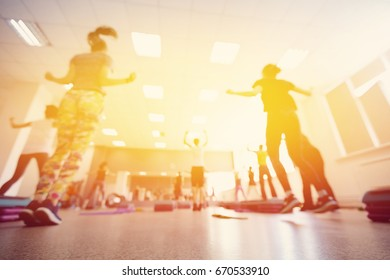 Blurred background of people group of girls playing in yoga and fitness in the gym.