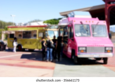 blurred background of people ordering at food truck
